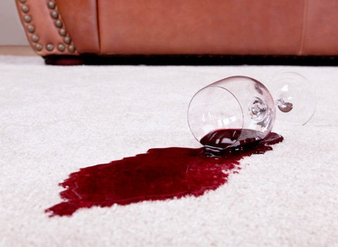 red wine stain on white carpet
